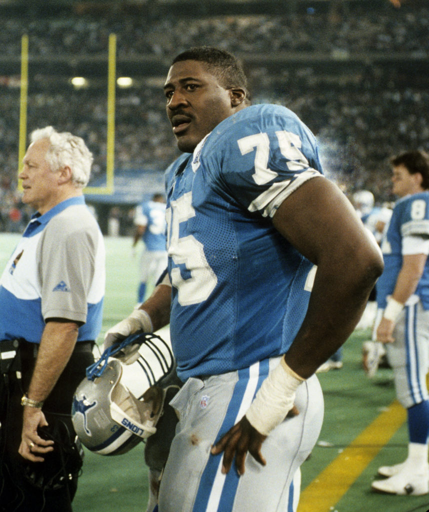 Detroit Lions tackle Lomas Brown (75) between offensive series during the NFL Wildcard Playoff, a 28-24 loss to the Green Bay Packers on January 8, 1994, at the Pontiac Silverdome in Pontiac, Michigan. (Photo by Betsy Peabody Rowe/Getty Images)